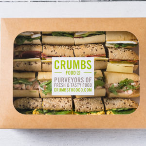 variety of sliced sandwiches in a box